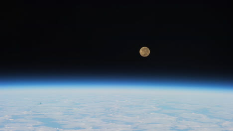 The-Moon-Sets-Over-The-Earth-As-Seen-From-The-International-Space-Station