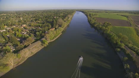 Aerial-Over-A-Boat-On-The-Sacramento-Or-American-River-In-California
