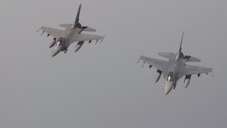 Two-Air-Force-F16-Jet-Fighters-Fly-In-Formation