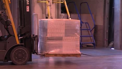 Forklifts-Move-Cargo-Items-On-Pallets-Around-A-Warehouse-For-Shipping-1