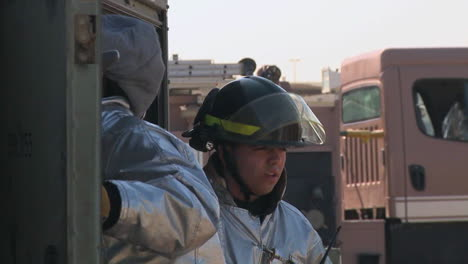 Firefighters-Perform-An-Auto-Extrication-Exercise-On-A-War-Vehicle