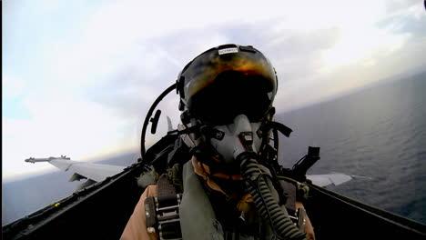 Pov-Shot-Of-A-Fighter-Jet-Landing-On-An-Aircraft-Carrier