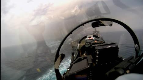 Pov-Shot-Of-A-Fighter-Jet-Landing-On-An-Aircraft-Carrier-2