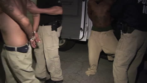 Drug-Dealing-Suspects-Are-Taken-From-A-Van-And-Led-Away