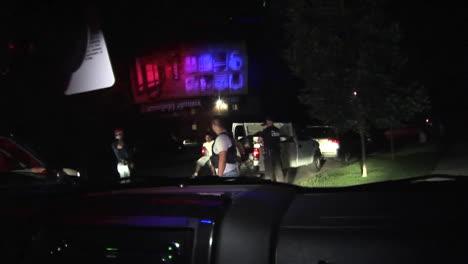 A-Police-Car-Arrives-At-A-Gang-Drug-Arrest