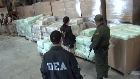 Dea-Agents-Guard-Confiscated-Drugs-In-A-Warehouse-1