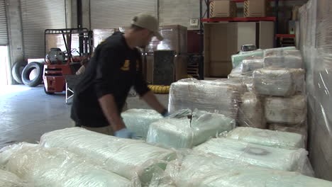 Dea-Agents-Stack-Confiscated-Drugs-In-A-Warehouse