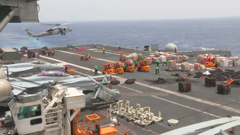 The-Deck-Of-A-Us-Aircraft-Carrier-Is-Prepared-For-A-Humanitarian-Airlift