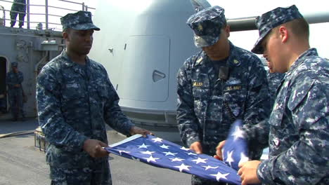 Navy-Sailors-Fold-The-American-Flag