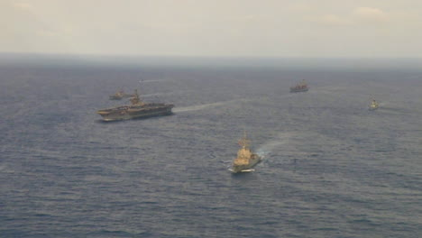 Aerials-Over-An-Aircraft-Carrier-And-Strike-Group-On-The-High-Seas