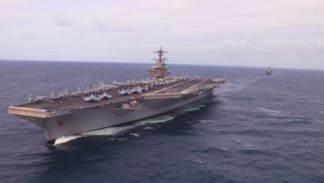 Aerials-Over-An-Aircraft-Carrier-And-Strike-Group-On-The-High-Seas-6