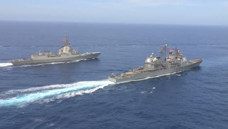 Aerial-Shots-Over-Aircraft-Carrier-And-Other-Navy-Craft-On-The-Sea