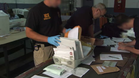 Special-Agents-From-The-Us-Immigration-And-Customs-Service-Confiscate-Illegal-Pharmaceuticals