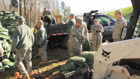 Army-Volunteers-Work-To-Sandbag-A-Flooded-Area-During-A-Storm
