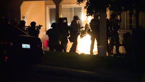 Los-Angeles-Police-And-Federal-Agents-Raid-A-Residence-In-Los-Angeles