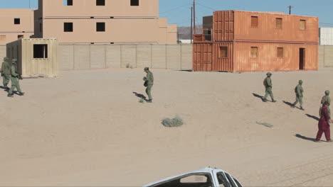 United-States-Troops-Practice-Various-Dangerous-Scenarios-In-A-Mock-Arab-Village-In-The-American-Desert