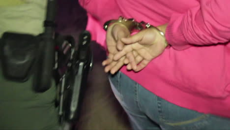 A-Swat-Team-Takes-Suspects-Into-Custody-From-A-Drug-House-At-Night