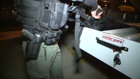 A-Swat-Team-Uses-Military-Style-Weapons-And-Vehicles-In-A-Mall-Parking-Lot-2