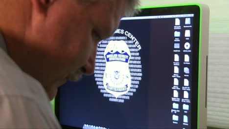 An-Investigator-Works-To-Examine-A-Hard-Drive-In-The-Cyber-Crime-Center-Of-Homeland-Security