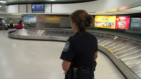 A-Homeland-Security-Agent-Walks-Through-An-Airport