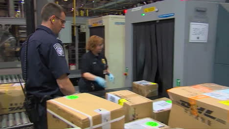 Homeland-Security-Agents-Search-A-Suspicious-Package-In-A-Shipping-Facility