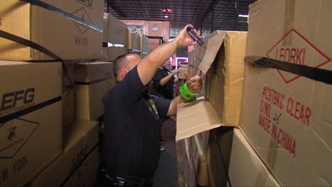 Homeland-Security-Agents-Search-Through-A-Shipping-Facility-For-Illegal-Goods