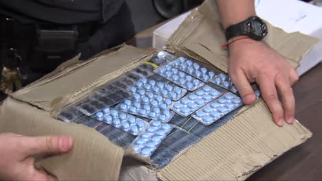 Agents-From-Us-Customs-Seize-Fake-Prescription-Drugs-At-A-Shipping-Facility-3
