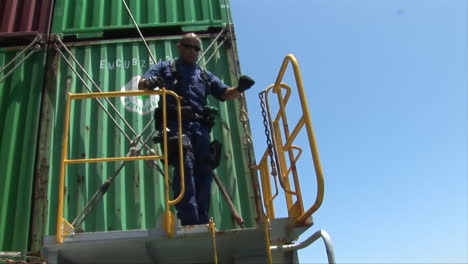 Agents-From-Us-Customs-At-The-Port-Of-Long-Beach-Board-A-Ship-To-Inspect-Cargo-1