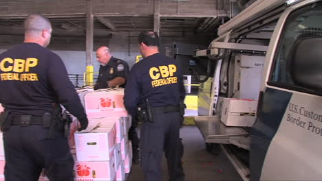 Agents-From-Us-Customs-At-A-Port-Warehouse-Inspect-Produce
