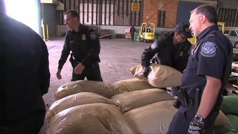 Agents-From-Us-Customs-At-A-Port-Warehouse-Inspect-Produce-1