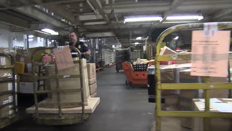 Homeland-Security-Agents-Search-Through-A-Warehouse-In-A-Shipping-Facility-2
