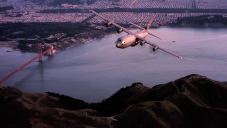 Aerials-Of-The-Us-Air-Force-Air-Mobility-Command-C130J-In-Flight-Over-San-Francisco-And-The-Golden-Gate-Bridge