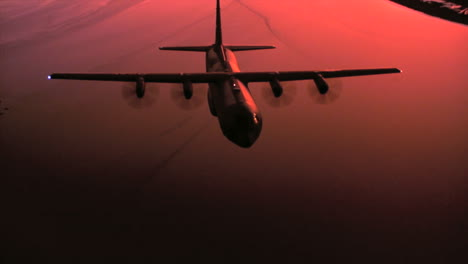 Aerials-Of-The-Us-Air-Force-Air-Mobility-Command-C130J-In-Flight-At-Sunset