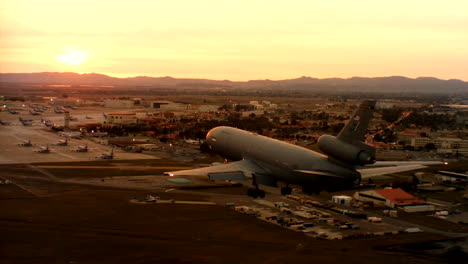 Aerials-Of-The-Us-Air-Force-Air-Mobility-Command-Kc10-Landing-At-Sunset