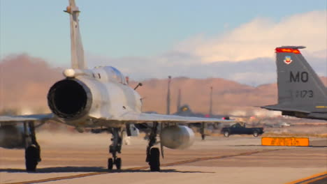 Fighter-Jets-From-The-United-Arab-Emirates-Taxi-On-A-Runway-At-A-Military-Base