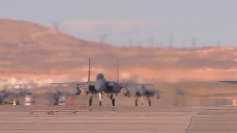 F15-And-F16-Fighter-Jets-Line-Up-And-Taxi-For-Takeoff-In-A-Military-Exercise
