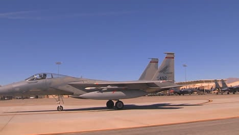 F15-And-F16-Fighter-Jets-Line-Up-And-Taxi-For-Takeoff-In-A-Military-Exercise-2