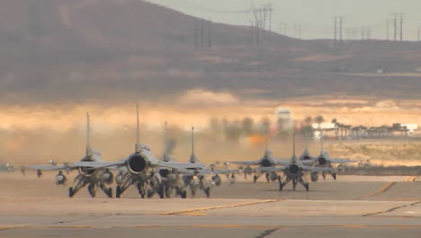 F15-And-F16-Fighter-Jets-Line-Up-And-Taxi-For-Takeoff-In-A-Military-Exercise-3