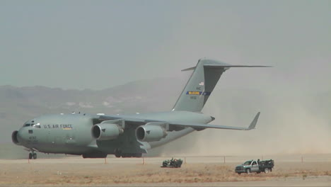 A-C130-Cargo-Plane-Taxis-On-A-Dirt-Runway-In-The-Desert