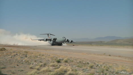A-C130-Cargo-Plane-Takes-Off-From-A-Dirt-Runway-In-The-Desert-1