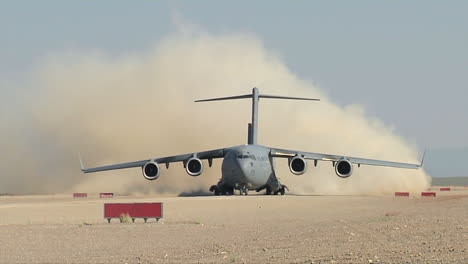 A-C130-Cargo-Plane-Takes-Off-From-A-Dirt-Runway-In-The-Desert-2
