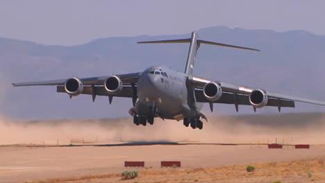 A-C130-Cargo-Plane-Lands-On-A-Dirt-Runway-In-The-Desert-1