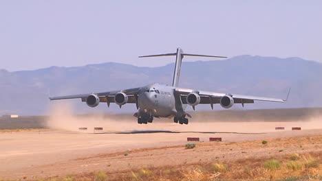 A-C130-Cargo-Plane-Lands-On-A-Dirt-Runway-In-The-Desert-2