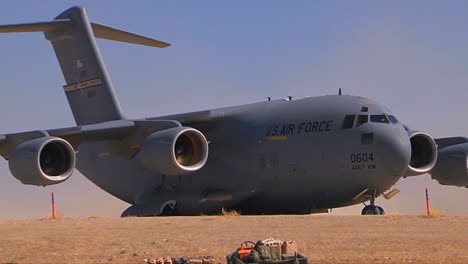 A-C130-Cargo-Plane-Takes-Off-From-A-Dirt-Runway-In-The-Desert-3