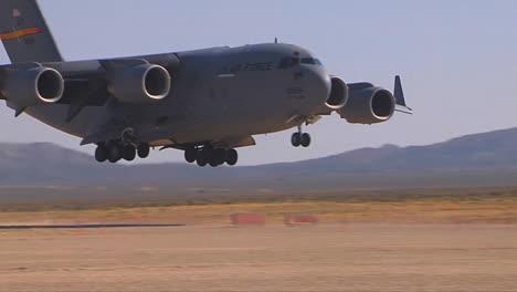 A-C130-Cargo-Plane-Lands-On-A-Dirt-Runway-In-The-Desert-3