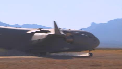 A-C130-Cargo-Plane-Lands-On-A-Dirt-Runway-In-The-Desert-4