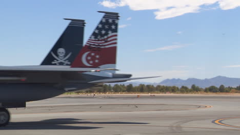 F15-And-F16-Fighter-Jets-Line-Up-And-Taxi-For-Takeoff-In-A-Military-Exercise-5