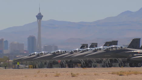 Numerous-F15-And-F16-Fighter-Jets-Line-Up-And-Taxi-For-Takeoff-In-A-Military-Exercise