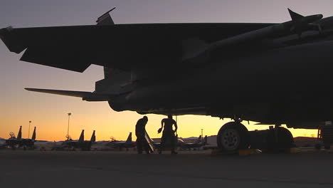 Fighter-Pilots-Prepare-Their-Jets-On-A-Runway-At-Dusk