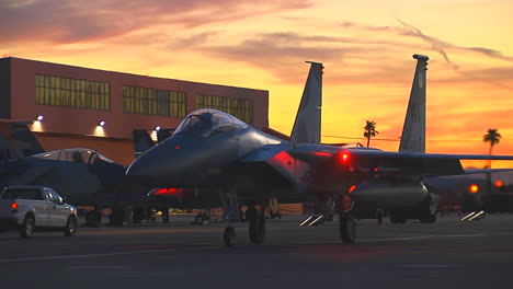 F15-Fighter-Jets-Taxis-On-A-Runway-At-Sunset